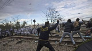 Macedonian police getting the love treatment from young tough refugees