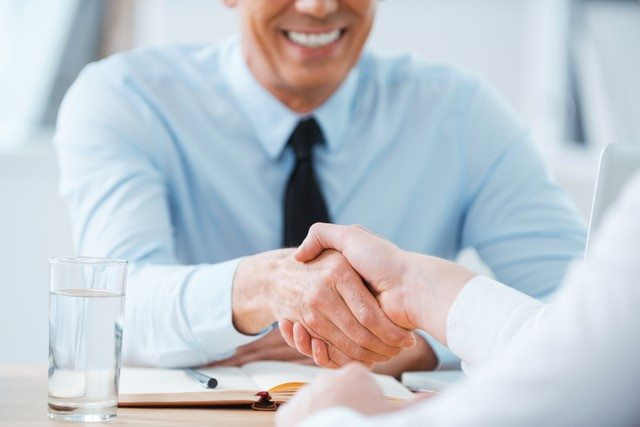 Veterinarians shaking hands at an interview