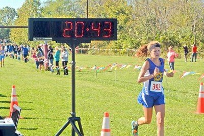 Rising Sun's Kasey Baker reaches the finish line with a 10th place finish in the South Dearborn Sectional.