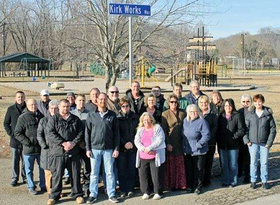 A large group of county residents joined the members of the Vevay Town Council on Monday afternoon in the Paul Ogle Riverfront Park to change the name of Lafayette Street in the Park to Kirk Works Way. The name change honors the longtime President of the Swiss Wine Festival