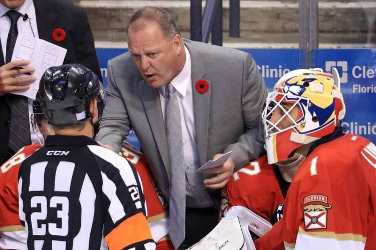 Vegas Golden Knights head coach Gerard Gallant dons a red poppy while speaking to a linesman when he was head coach for the Florida Panthers