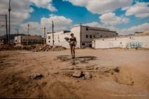 """Pista de baile del nightclub """"La Madelón"""" (Pista da ballo del nightclub """"La Madelón""""), 2016 Stampa su carta cotone Prostituta transessuale in piedi sul pavimento della pista da ballo del club demolito a Ciudad Juárez, Mexico. 125x185 cm, con cornice"""