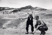 ITALY. Near Troina. August 4-5, 1943. Sicilian peasant telling an American officer which way the Germans had gone.