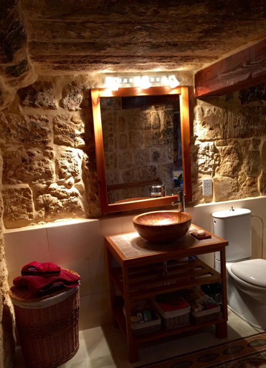 Gorgeous bathroom in a restored farmhouse in Gozo
