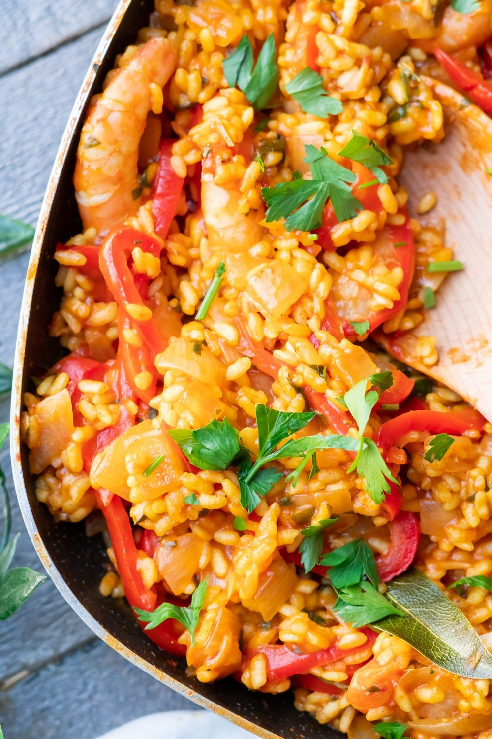 Large pan of vibrant dish made by this easy paella recipe