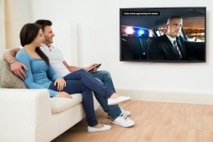 couple watching closed captioned video