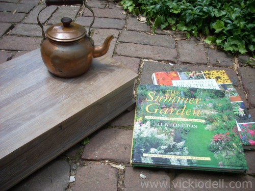 Vintage silver box, tea kettle and gardening books