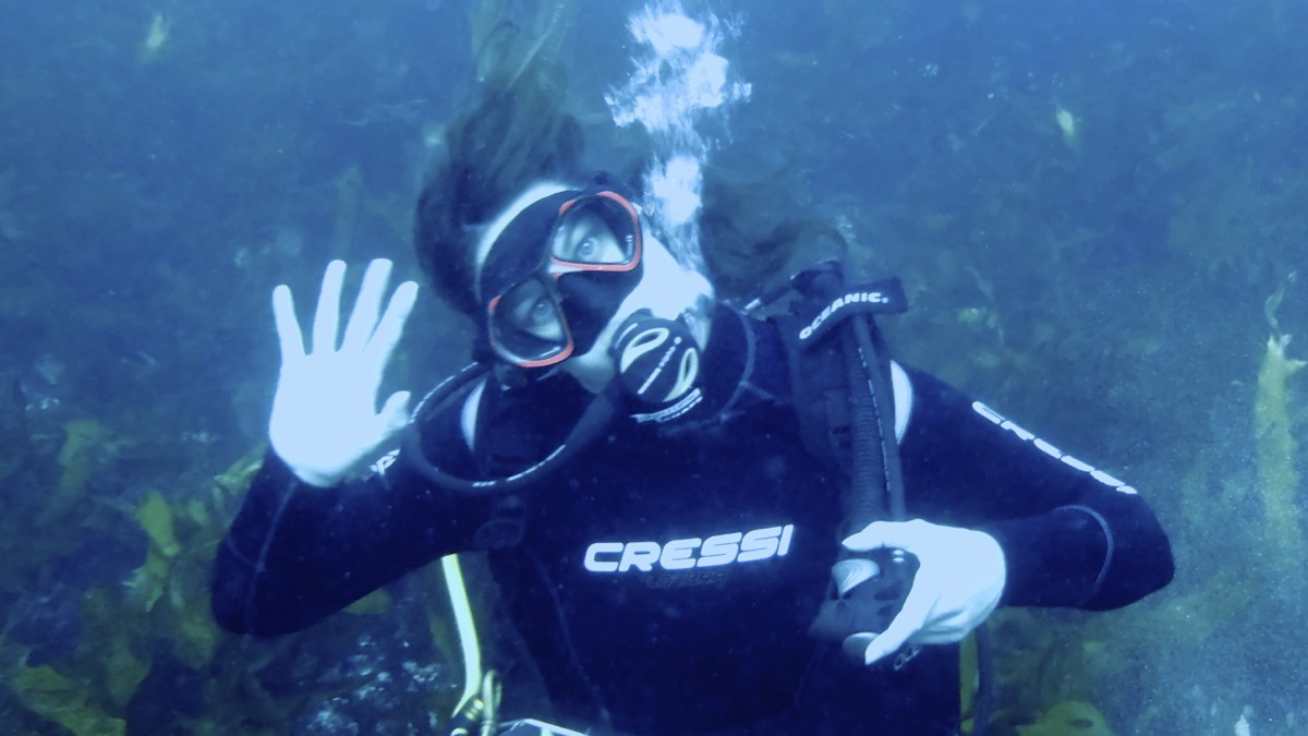 Me waving underwater
