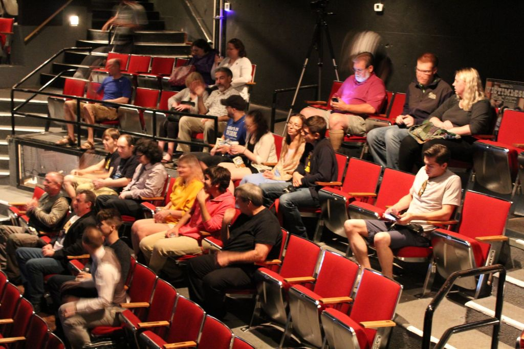 The audience, prior to the beginning of the movie.