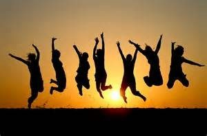 Group jumping for joy at sunset