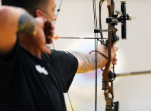 Used for equipment related posts. Rear shot of a military personnel with compound bow at full draw. From Wikimedia Commons.