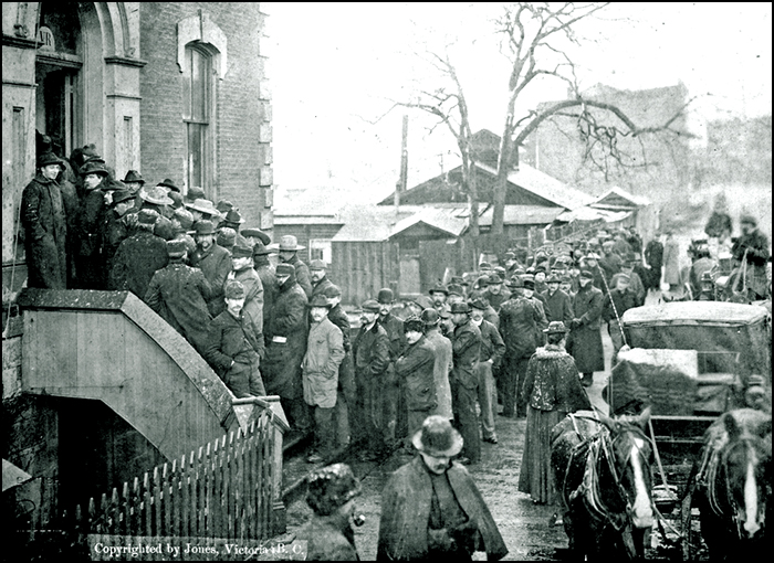 Klondikers buying miner's licenses at Custom House, Victoria, B C.