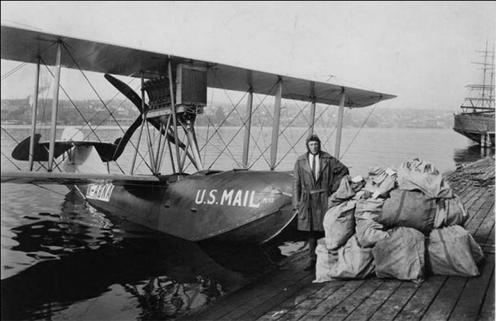 Eddie Hubbard in his leather flying coat with his Boeing B1 and mail. image courtesy of the Seattle Museum of History and Industry