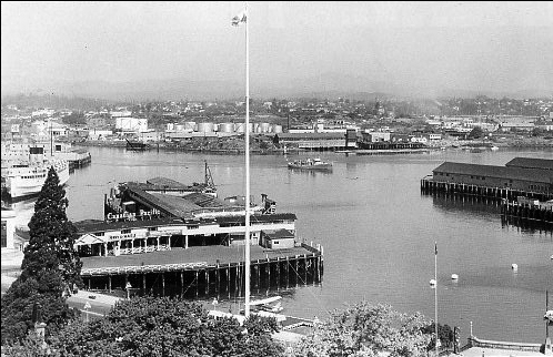 A Victoria Flying Service aircraft bottom centre facing the Canadian Pacific's British Columbia Steamship Services pier to the left.