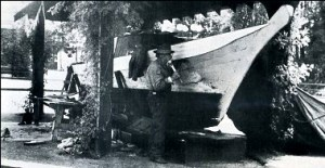 Captain Jacobsen recaulking Tilikum's seams at Thunderbird Park in 1937.