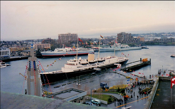 HMY Britannia at Ship Point with her escort HMCS Yukon astern MV Coho in Victoria's Inner Harbour in 1971.