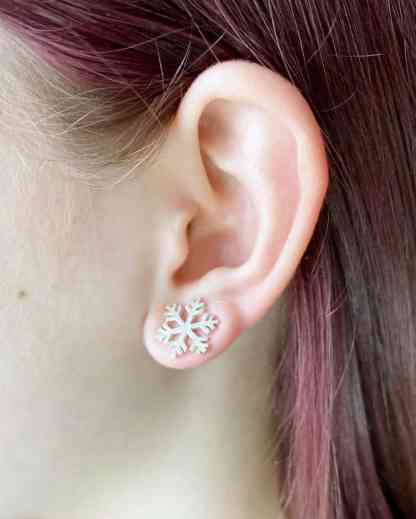 Large snowflake studs on ear