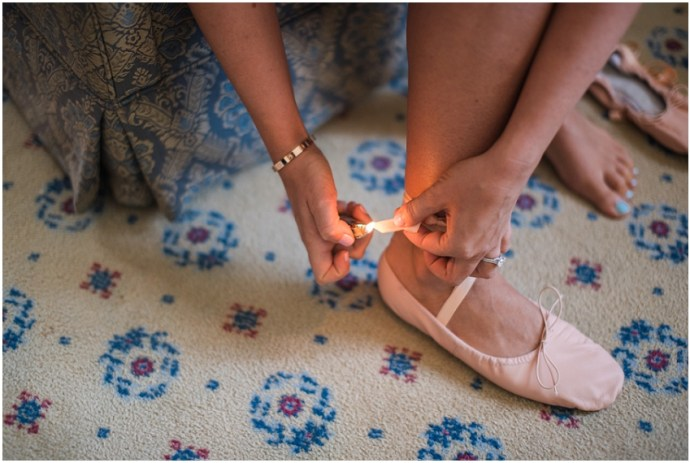 Bride wearing pink ballet slippers for her wedding