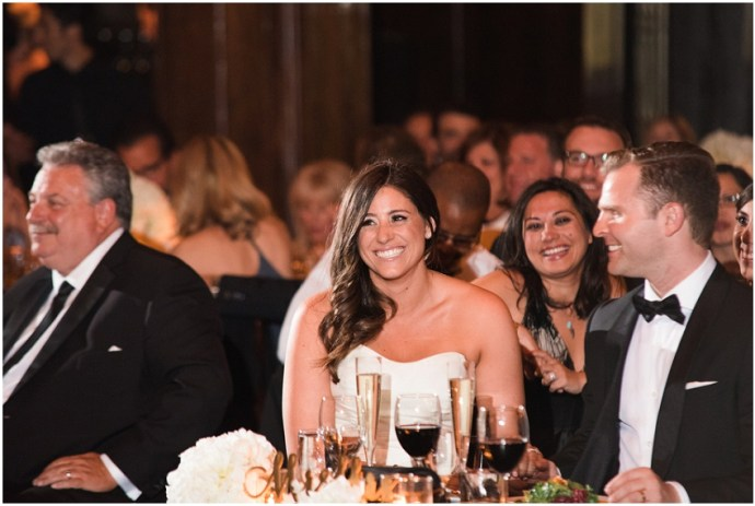 Bride and groom listening to speaches during a wdding