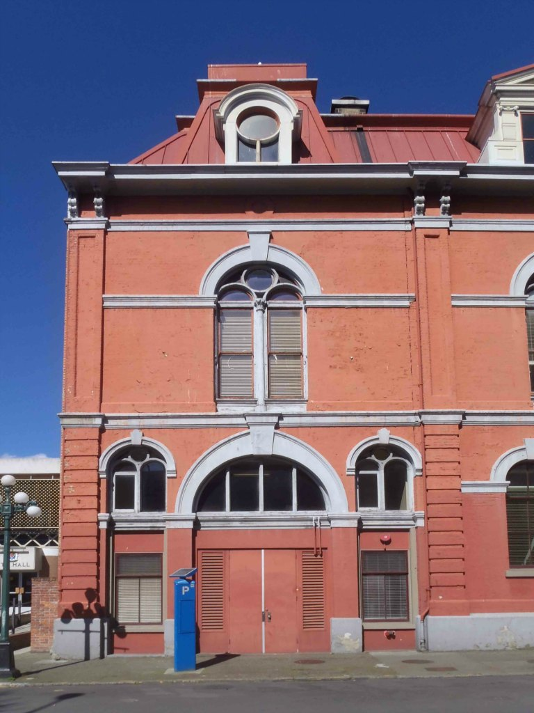 Part of the 1881 addition to Victoria City Hall, showing the arch outlining the fire hall entrance (photo by Victoria Online Sightseeing Tours)
