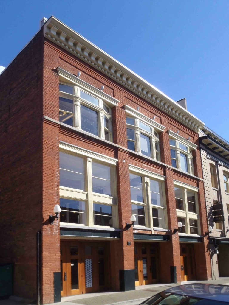 The Langley Street facade of the Promis Block, <a href=