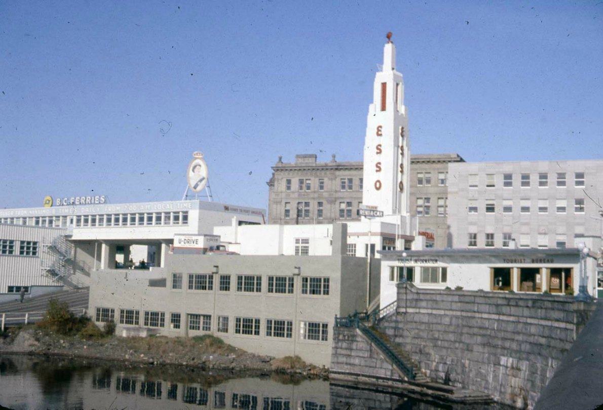 812 Wharf Street as an ESSO station, circa 1960. Note the adjacent BC Ferries terminal. (photo courtesy of Glenbow Museum, used with permission)