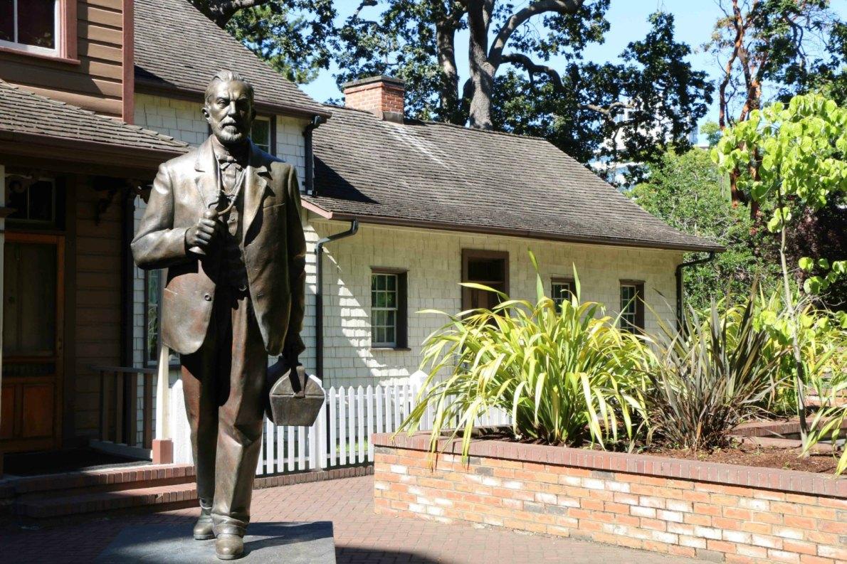 Helmcken House and the statue of Dr. John Sebastian Helmcken, Thunderbird Park