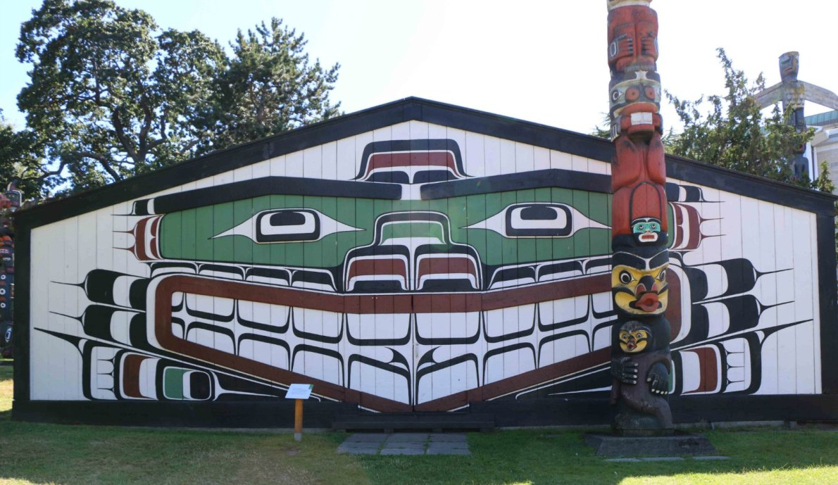 Wawadit'la, also known as Mungo Martin House, was built on this site in 1953. The Kwakwaka'walw Heraldic Pole in front of the building was also carved in 1953. (photo by Victoria Online Sightseeing Tours)