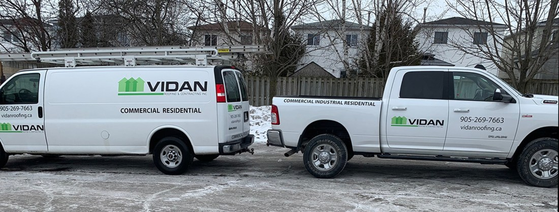 Vidan Roofing Trucks on a job.