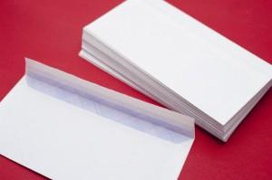 Pile of blank white envelopes