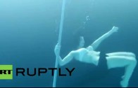 Underwater Pole Dancers Shimmy Beneath The Waves