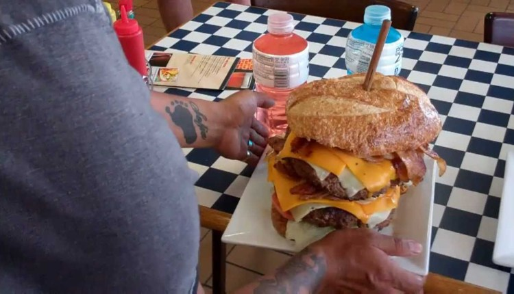 A Challenge Of Eating 8 Pounds Burger