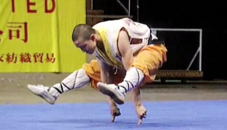 Shaolin Monk Balances On 2 Fingers