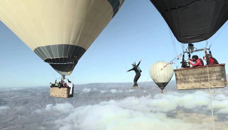 Tightrope Walk Between Two Hot Air Balloons