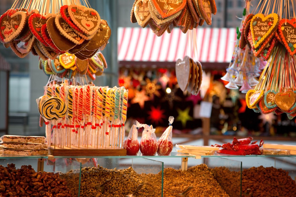 Gingerbreads, candies and nuts displayed on a Christmas market s