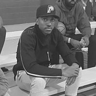 Jeff Teague wearing a Pacers hat while watching one of his AAU teams. [Photo by Defro]