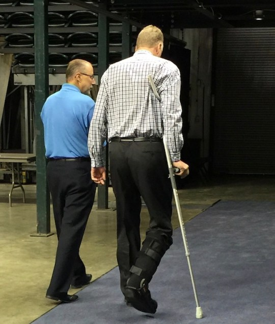 Bird leaves the court with Media Relations Director David Benner.
