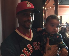 Hill with his son, Zayden, who's seven months old.