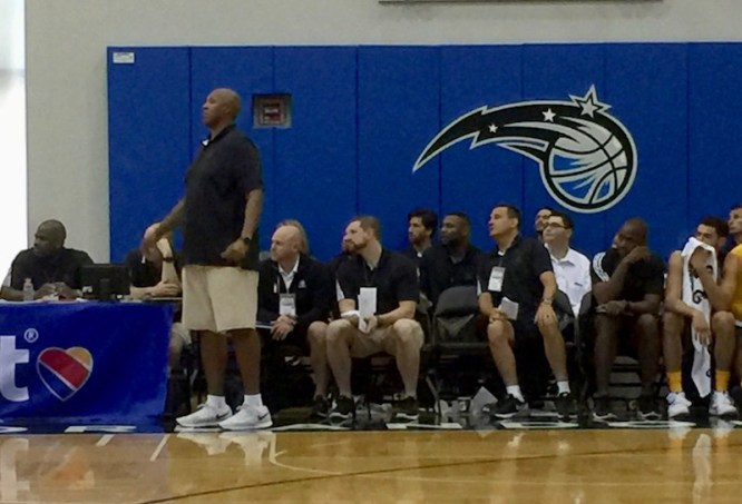 Simpson (right, beside Niang) was on Popeye Jones's coaching staff for Summer League.
