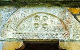 A 12th century Norman frieze in the market town of Broadwell, Gloucestershore