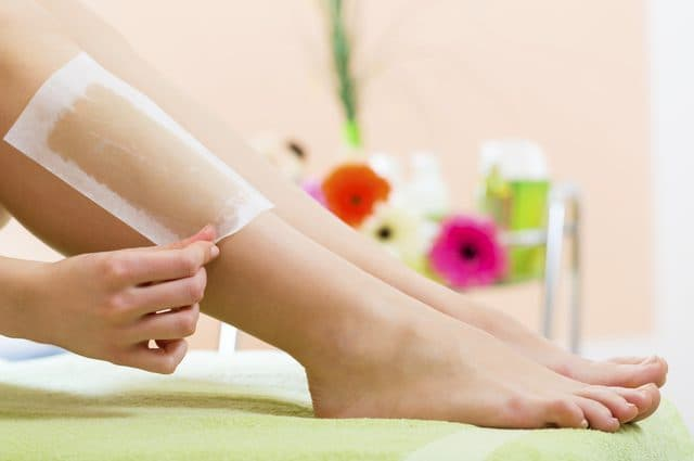 Waxing  to remove unwanted hair