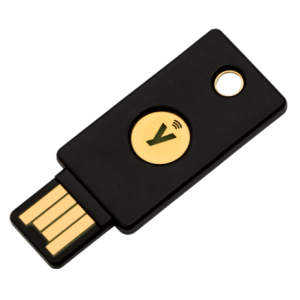 black and gold dongle with a usb input made by yubikey