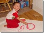 Criançada pintando a lona