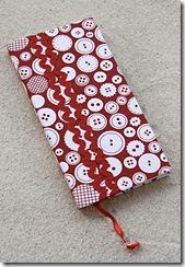 Agenda de bolso com tecido de botões