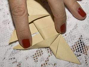 Ajeite as laterais e forme dois novos triângulos