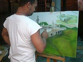 João Ricardo Nóbrega pintando uma de suas telas
