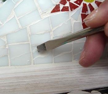 Limpe também na parte interior da bandeja