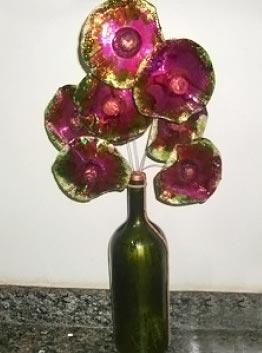 Flores feitas com CDs reciclados
