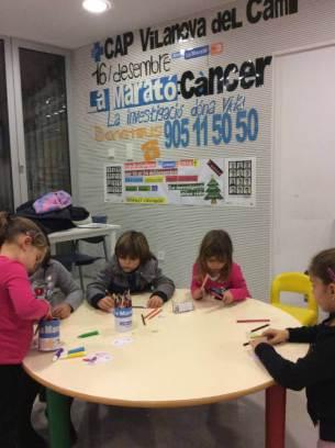 Nens fent xapes per la Marato al CAP