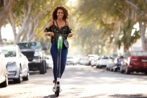 woman riding scooters - staying safe on an electric scooter and scooter injuries - viles and beckman - fort myers florida
